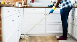 Photo of a person cleaning the kitchen