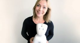 Karen Dolva with No Isolation's AV1 robot.