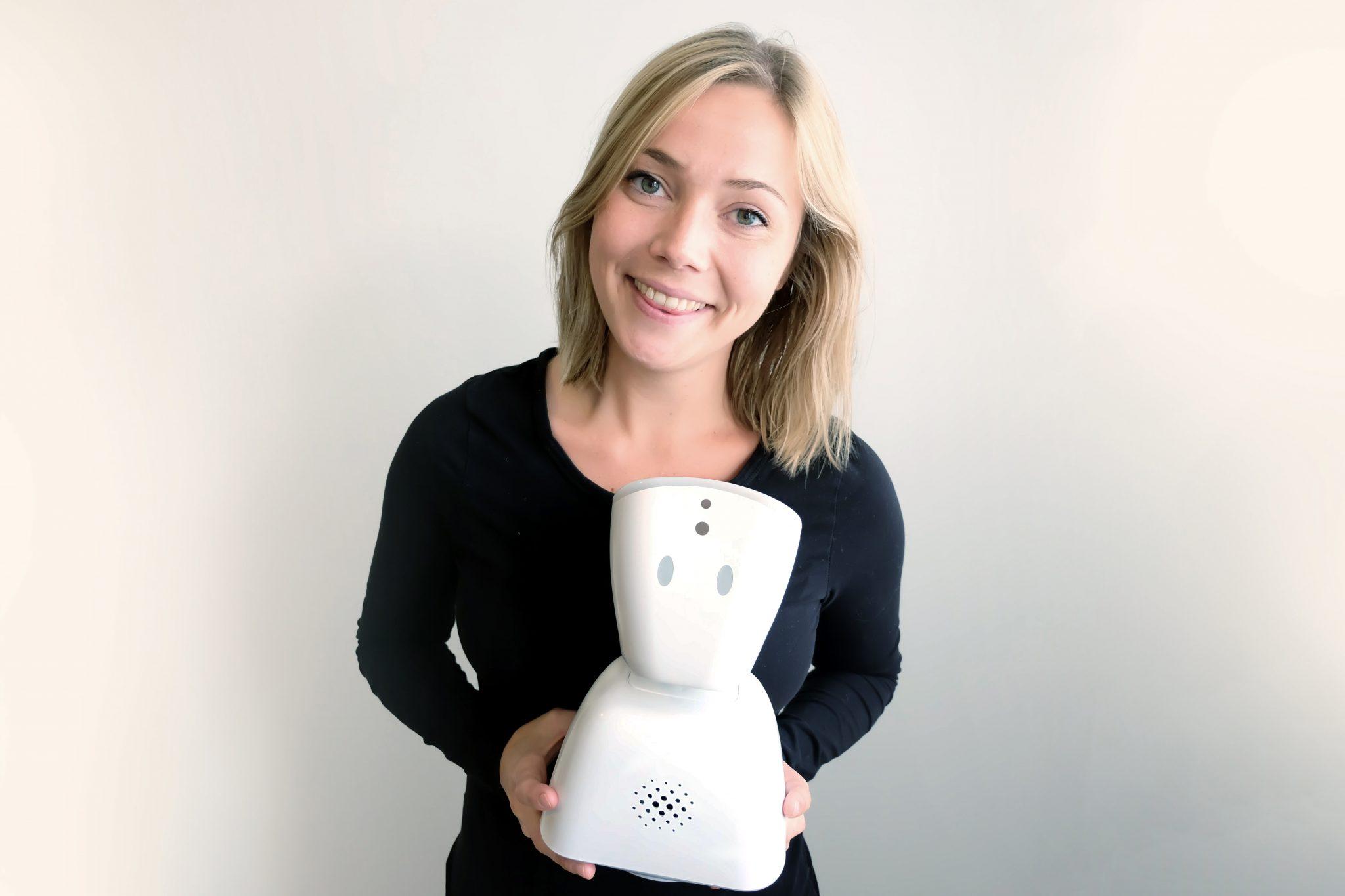 Karen Dolva with No Isolation's AV1 robot.