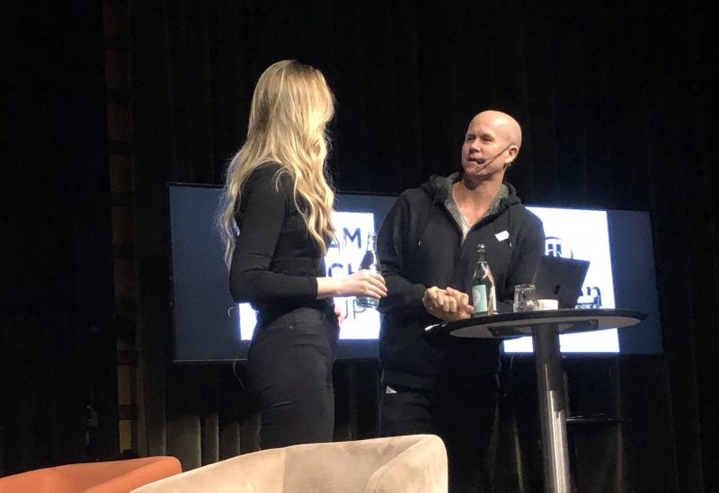 Image of Tuva Palm and Tyler Crowley on stage during one of their monthly tech meet-ups in Stockholm