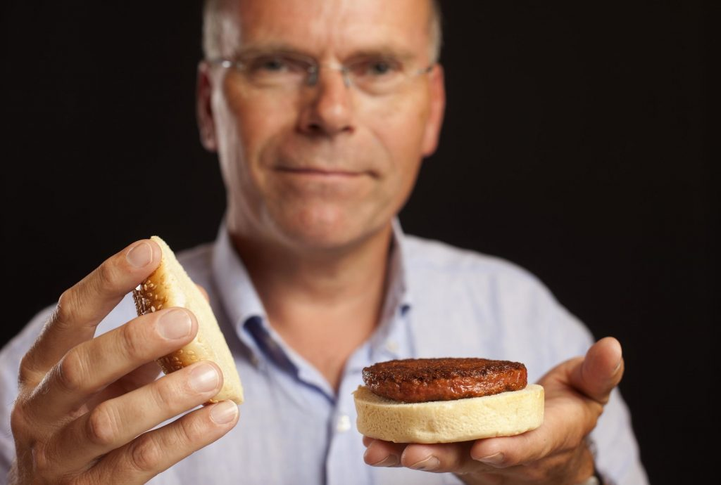 Mark Post presenting the first lab-grown burger in 2014. Credit: Mosa Meat/David Parry/PA