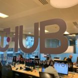 Image of the jHub sign from their office space