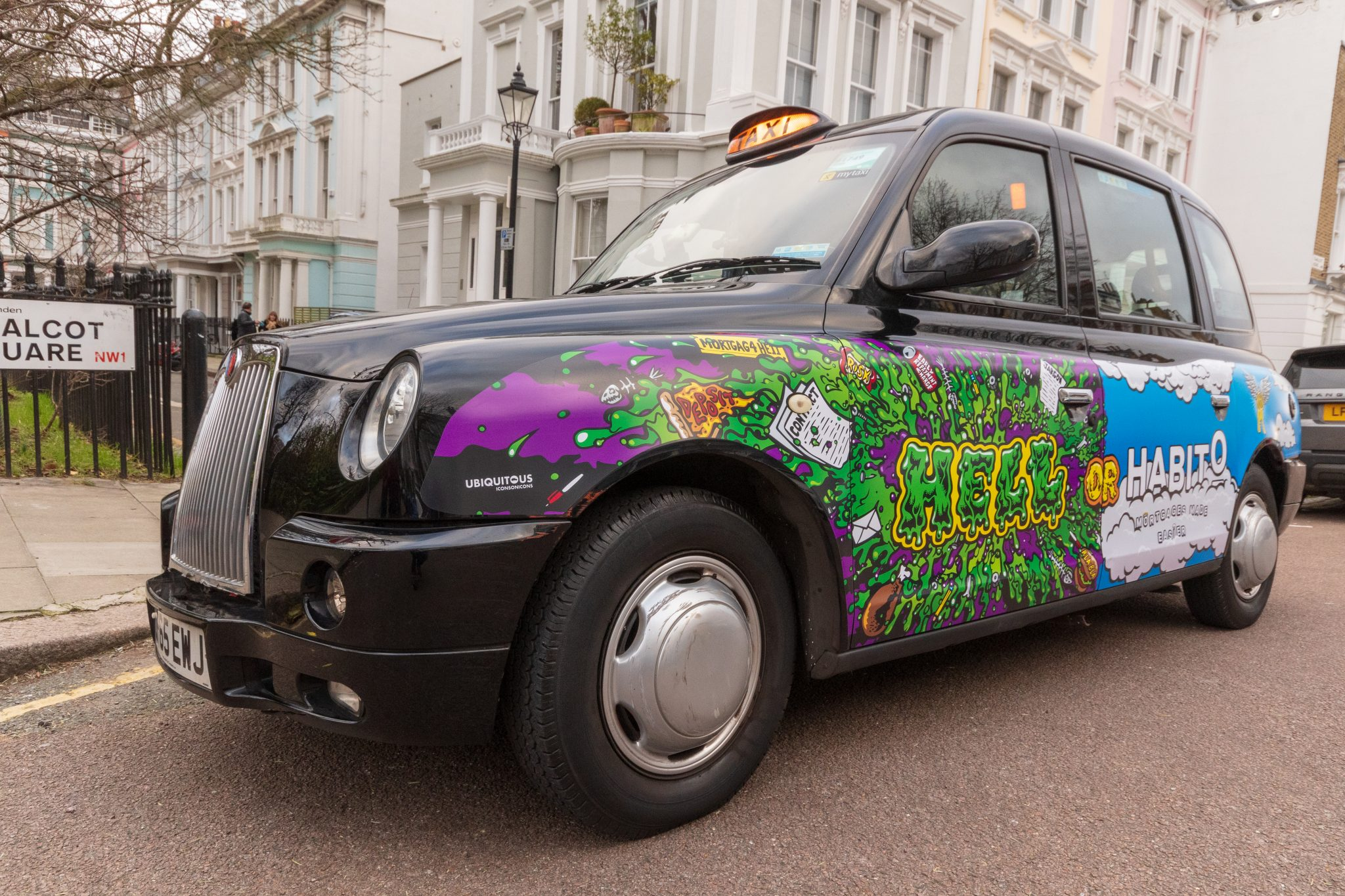 A Habito advert on a black cab in London.