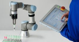 Pipette machine and dashboard on a tablet for science lab tech