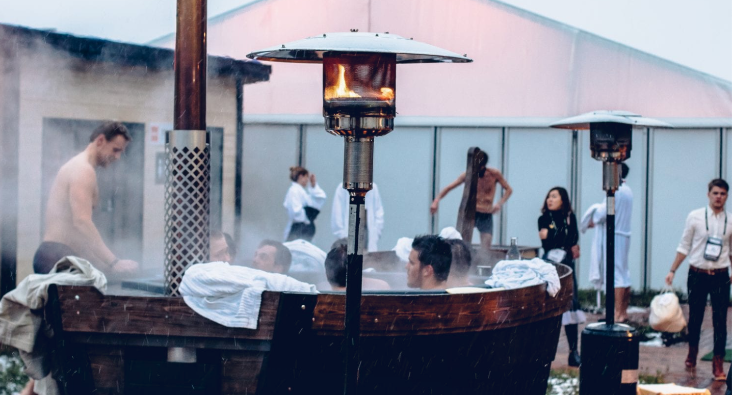 Image of men steaming in an open air sauna during a tech conference sauna party