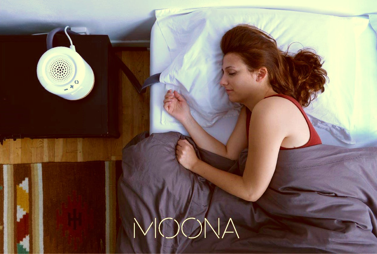 Image of woman lying asleep in bed on a Moona cooling pillow – the pillow created to relieve menopause issues