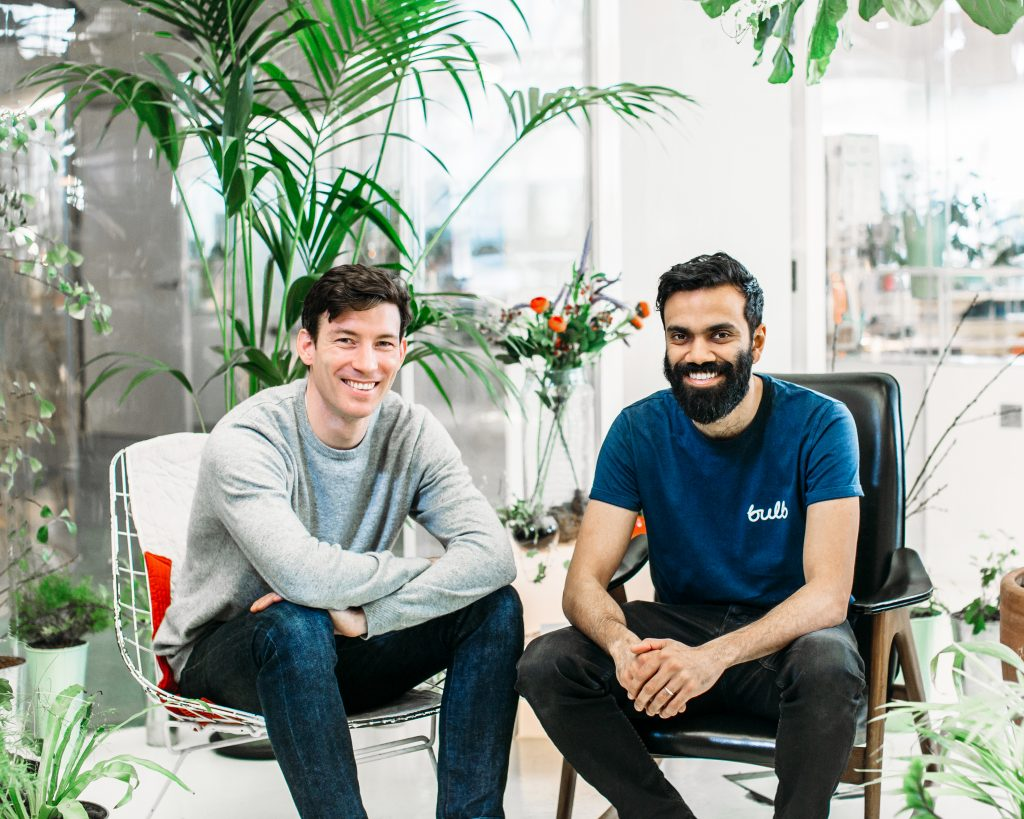 Photo of Bulb founders, Hayden Wood and Amit Gudka, in their leafy old office space.