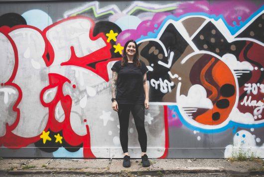 Hannah Cox against wall