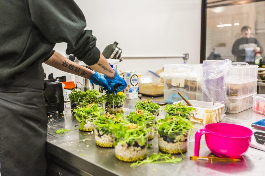 Photo of food preparation inside Karma Kitchen.