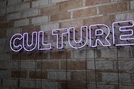 CULTURE - Glowing Neon Sign on stonework wall - 3D rendered royalty free stock illustration. Can be used for online banner ads and direct mailers.