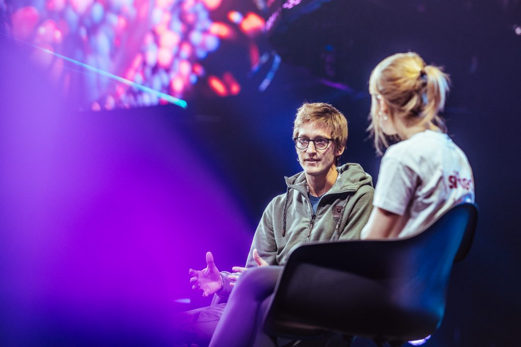 Photo of Oscar Pierre, Glovo CEO, talking to Sifted onstage at Slush.