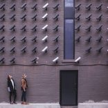 Picture of two women being watched by security cameras