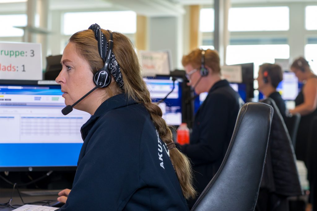 Picture of responders taking calls at Denmark's emergency helpline