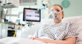 Picture of a woman using a Ventura CPAP machine