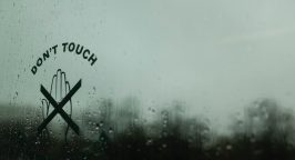 Image of glass with a Don't Touch sign