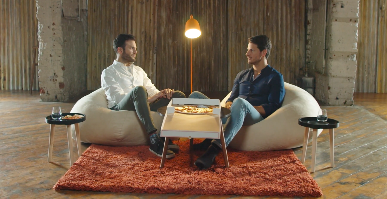 Photo of JP and Ryan eating pizza and talking