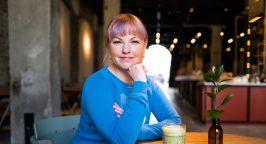 Photo of Karoli Hindriks, CEO of Jobbatical in a cafe