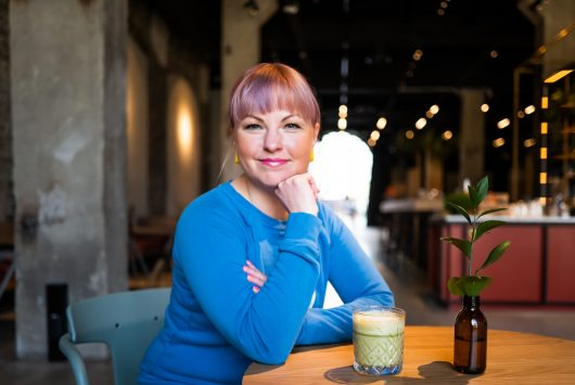 Photo of Karoli Hindriks, CEO of Jobbatical in a cafe