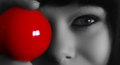 Woman holding red ball