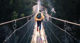 Person running over a bridge