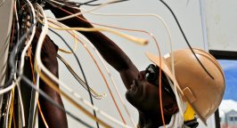 man fixing electric cables