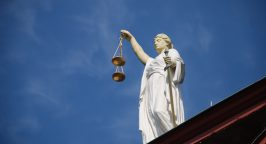 Picture of a statue of Justice holding scales