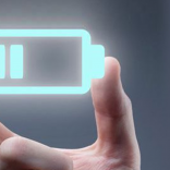 Image of hand holding a neon battery