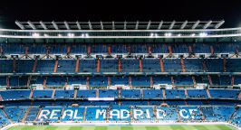 Real Madrid stadium with a few fans