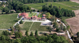 An aerial photo of vineyard startup accelerator Chateau Le Sartre bordeaux france