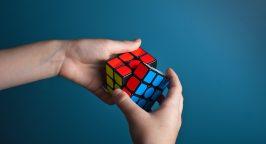 Hands doing a Rubik's cube
