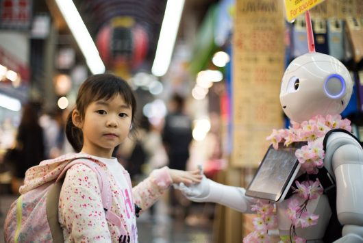 Photo of a girl with a robot by Andy Kelly