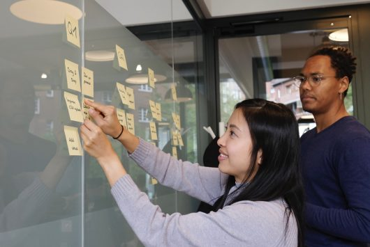 Man and woman making business plan