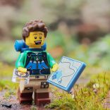 Lego man with a map and backpack