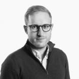 Headshot of Jordan Schlipf CEO of Rainmaking Venture Studio