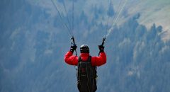 Person jumping with a parachute