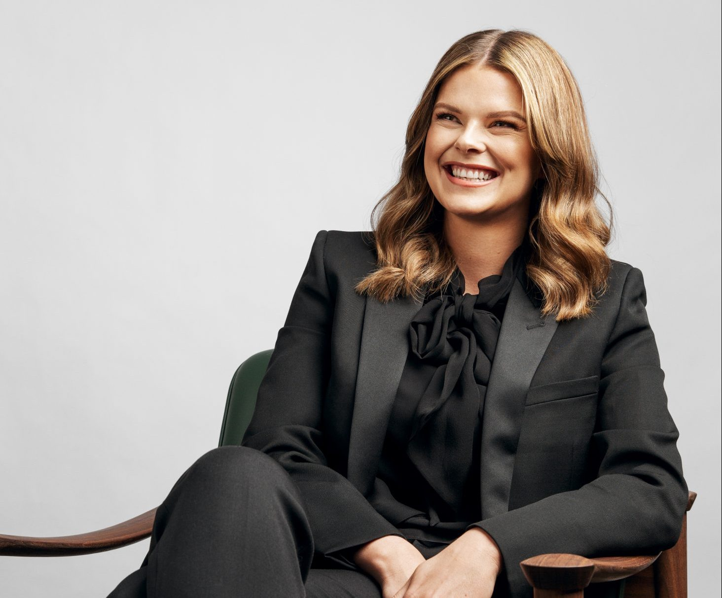 Linnea Kornehead sitting on chair smiling