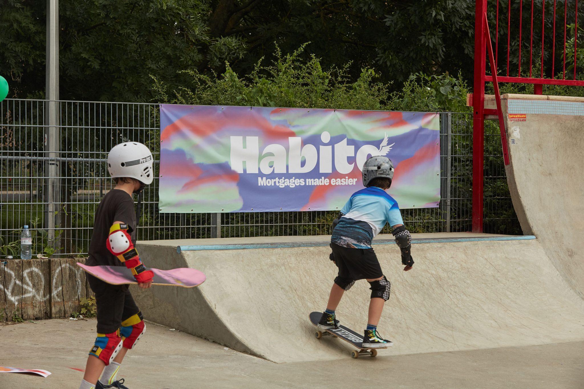 Children on skatepark with Habito branding in the background.